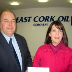 Pictured is Con Ryan of East Cork Oil handing over a sponsorship cheque to Sinéad Hickey of the website committee.